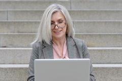 Attractive professional woman using a laptop stock photos