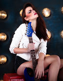 Attractive punk girl with cool make up holding guitar Stock Photo