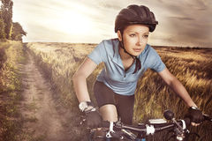 Attractive purposeful in sports equipment active girl riding a r. Acing bike. Sport's concept Royalty Free Stock Image