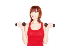 Attractive readhead female lifting weights Royalty Free Stock Photos
