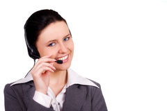 Attractive receptionist. Beautiful Customer Representative girl with headset royalty free stock photos