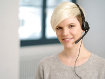 Attractive receptionist with headset Stock Photo