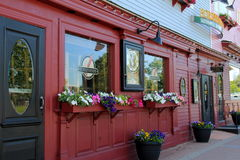 Attractive red and black storefronts, with welcoming signs to come in, Horsefeathers Restaurant, North Conway, NH, 2016. Gorgeous storefronts in red and black Stock Photography