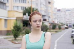 Attractive red hair girl on the street royalty free stock image