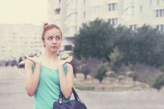 Attractive red hair girl on the street royalty free stock photography