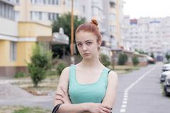 Attractive red hair girl on the street stock images