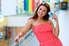 Attractive red hair woman with credit cards Stock Image
