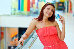 Attractive red hair woman with credit cards Royalty Free Stock Photo