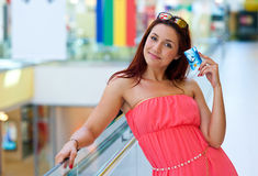 Attractive red hair woman with credit cards Stock Photo