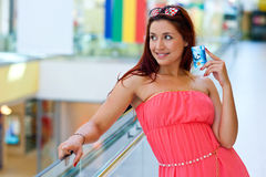 Attractive red hair woman with credit cards Royalty Free Stock Photos