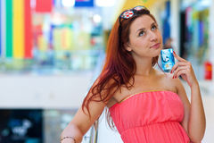 Attractive red hair woman with credit cards Royalty Free Stock Images
