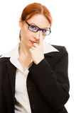 Attractive red-haired  business woman in glasses Royalty Free Stock Image