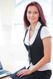 Attractive red-haired businessgirl Stock Photo