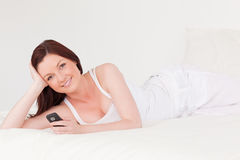 Attractive red-haired female relaxing Stock Image