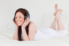 Attractive red-haired female relaxing Stock Images