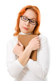 Attractive red-haired girl in glasses with book. Stock Photo