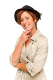 Attractive Red Haired Girl Wearing a Trench Coat and Hat. Attractive Red Haired Girl Wearing a Trenchcoat and Hat Isolated on a White Background stock photography