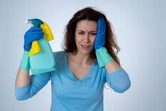Attractive red haired woman bored and restless of cleaning and housekeeping royalty free stock photos