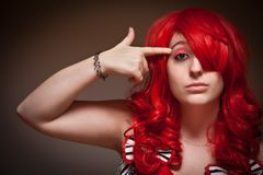 Attractive Red Haired Woman Wearing Bunny Ear Hat Stock Photography