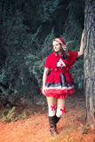 Attractive Red Riding Hood in the forest Royalty Free Stock Image