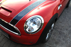 Attractive red sports car with a dark line Stock Photos