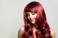Attractive redhead girl smiling. Beautiful woman with makeup royalty free stock photo