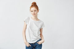 Attractive redhead girl smiling looking at camera. royalty free stock image