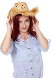 Attractive redhead girl with straw hat, isolated Stock Image