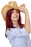 Attractive redhead girl with straw hat, isolated Stock Photography