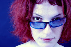 Attractive redhead girl wearing sunglasses. Royalty Free Stock Image