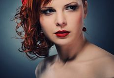 Attractive redhead woman. Portrait of an attractive redhead woman stock photo