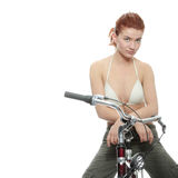 Attractive redhead woman with bike Stock Photography