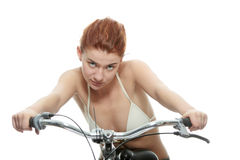 Attractive redhead woman with bike Royalty Free Stock Photo