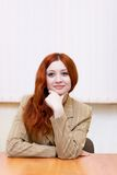 Attractive redhead woman in classic suit Royalty Free Stock Image