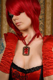 Attractive redhead woman in red corset Stock Image