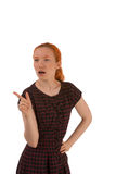 Woman thinking and pointing Stock Photography