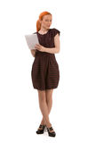 Attractive redhead woman writing notes Stock Image