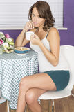 Attractive Relaxed Annoyed Young Woman Having Breakfast Drinking Coffee Royalty Free Stock Photography