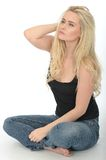 Attractive Relaxed Thoughtful Young Woman Sitting on the Floor Royalty Free Stock Images