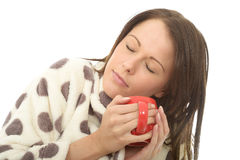 Attractive Relaxed Tired Cosy Young Woman Holding A Cup Of Tea Royalty Free Stock Images