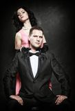 Attractive retro couple on black background Royalty Free Stock Photos