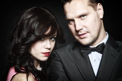 Attractive retro couple on black background Royalty Free Stock Images
