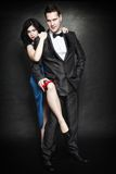 Attractive retro couple on black background Royalty Free Stock Photography