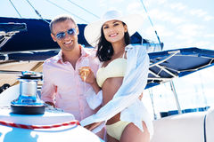 Attractive and rich couple have a party on a boat Stock Photo