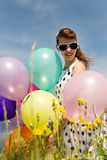 Attractive Rockabilly Girl with Balloons in the nature Stock Photo