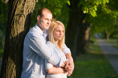 Attractive romantic couple in sunset light. Stock Image