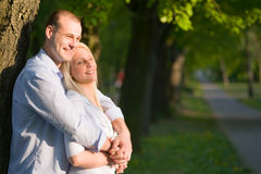 Attractive romantic couple in sunset light. Stock Photography