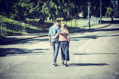 Attractive romantic couple, young man and girl standing royalty free stock image