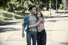 Attractive romantic couple, young man and girl standing stock image