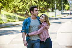 Attractive romantic couple, young man and girl standing royalty free stock images